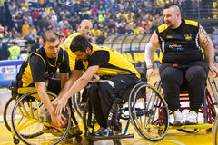Unidentified people play a friendly game of wheelchair basketbal Royalty Free Stock Photo