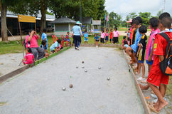 Unidentified people play petanque Stock Image