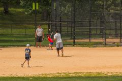 Unidentified people plays amateur baseball in Central Park. stock images
