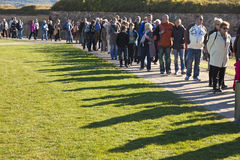 Unidentified people queuing up for Royalty Free Stock Photo