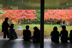 Unidentified people rest at a Zen garden inside Byodo-In Temple Royalty Free Stock Photo