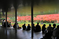 Unidentified people rest at a Zen garden inside Byodo-In Temple Royalty Free Stock Image