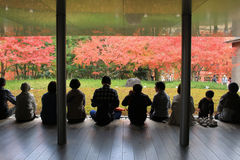 Unidentified people rest at a Zen garden inside Byodo-In Temple Stock Photo