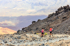 Unidentified people runs from the top of El Teide Volcano Stock Images
