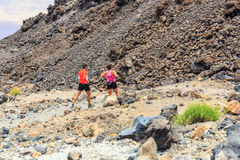Unidentified people runs from the top of El Teide Volcano, Tenerife, Spain Stock Photos