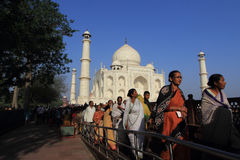 Unidentified people from rural villages visit the white marble mausoleum Taj Mahal in Agra, India. Stock Photo