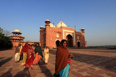 Unidentified people from rural villages visit the white marble mausoleum Taj Mahal in Agra, India. Royalty Free Stock Image