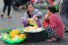 Unidentified people are selling foods and fruits on the street in Xuan Khanh wet market, Mekong delta area, Vietnam. Royalty Free Stock Photography