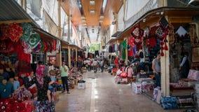 Unidentified people shopping in Adiyaman city historical old Oturakci bazaar inside the old city, Turkey Stock Image