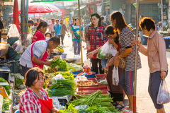 Unidentified people shopping in local market Royalty Free Stock Photography
