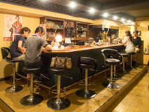 Unidentified people sitting at bar. Kyoto, Japan - June 28, 2014 : unidentified people sitting at bar Royalty Free Stock Images