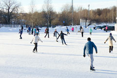 Unidentified people skating on the outdoors ice rink Stock Photography