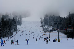 Unidentified people skiing and snowboarding in the ski resort Plai Royalty Free Stock Images