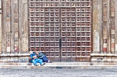 Unidentified people sleeping in front of old church in Naples Royalty Free Stock Images