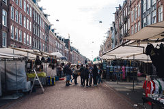 Unidentified people in street market in Amsterdam. Royalty Free Stock Images