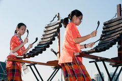 Unidentified people of Thai music band playing song by Pong Lang. Stock Photos