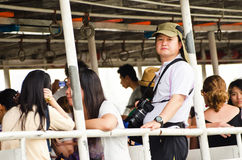 Unidentified people traveling on ferryboat. Royalty Free Stock Images