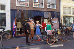 Unidentified people in vintage style clothes with their bicycles Royalty Free Stock Photography