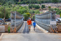 Unidentified people visit famous truss bridge over Aradena Gorge on Crete Island, Greece Royalty Free Stock Photos