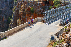 Unidentified people visit famous truss bridge over Aradena Gorge on Crete Island, Greece Royalty Free Stock Photo