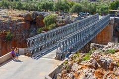 Unidentified people visit famous truss bridge over Aradena Gorge on Crete Island, Greece. Aradena, Crete, 25 May, 2016: unidentified people visit famous truss Stock Photography