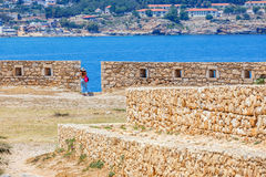 Unidentified people visit Venetian fortress Fortezza in Rethymno, Greece Stock Image