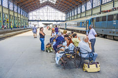 Unidentified people wait at  the train station in Budapest Stock Photo