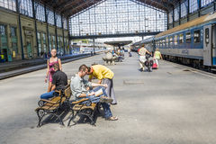 Unidentified people wait at  the train station in Budapest Stock Photos