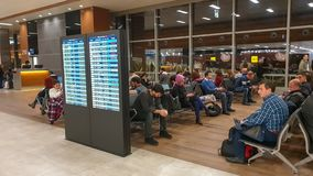 Unidentified people waiting for their flight in Sabiha Gokcen International Airport SAW in Istanbul, Turkey royalty free stock photo