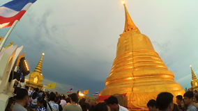 Unidentified people walk around and praying to pay respect to the Pagoda of Golden Mount stock footage