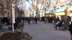 Unidentified people walk on a pedestrian zone stock footage