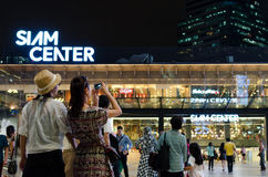 Unidentified people walk at Siam Center shopping mall Stock Photos