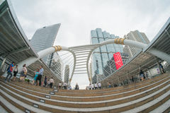 Unidentified people walk on skywalk in Sathorn district,Bangkok,Thailand. Bangkok,Thailand -  May 13,2015 : Unidentified people walk on skywalk in Sathorn Royalty Free Stock Images