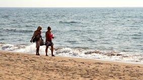 Unidentified people walking on the beach. Goa, India - February 22, 2015: Unidentified people walking on the beach stock footage