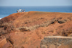 Unidentified people walking  in El Golfo and Green Lagoon Royalty Free Stock Image