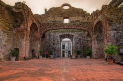 Unidentified people walking inside of ruins of the Jesuits Convent. Part of Casco Antiguo`s UNESCO patrimony in old. Panama city, which was destroyed by a fire royalty free stock images