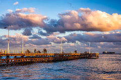 Unidentified people walking the pier on a winter day. Limassol, Royalty Free Stock Images