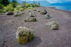 Unidentified people walking in the shore of the Lake Todos Los Santos, Region in Chile.  royalty free stock photo