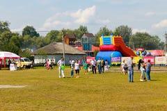Unidentified people walking on the Sorochintsy Fair. Velyki Sorochyntsi, Ukraine - August 20, 2016: Unidentified people walking on the Sorochintsy Fair in Velyki Stock Photography