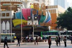 Unidentified people walks around the Casino Lisboa in Macau Stock Photos