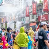 Unidentified people in water fight for Songkran Festival stock image