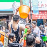 Unidentified people in water fight for Songkran Festival stock photo