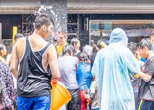Unidentified people in water fight for Songkran Festival stock photos