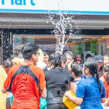 Unidentified people in water fight for Songkran Festival royalty free stock image