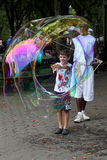 Unidentified performer and kids play with soap bubbles at Centra Stock Photography