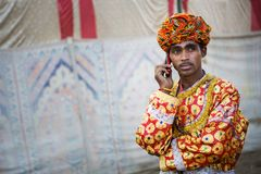 Camel trader in pushkar camel fair. Unidentified person and a trader in pushkar camel tradee fair in rajasthan, india on november 2015 Stock Photos