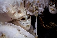 Unidentified person with Venetian Carnival mask in Venice, Italy on February stock image