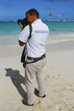 Unidentified photographer from Royalton All-inclusive Resort and Casino at the Bavaro beach Stock Images
