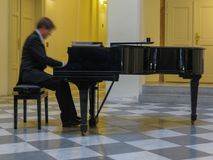 Unidentified piano player in Prague Stock Image