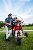Unidentified pilot and children with paragider preparation take off Royalty Free Stock Photo